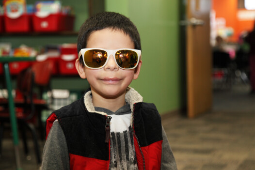 elementary student in sunglasses